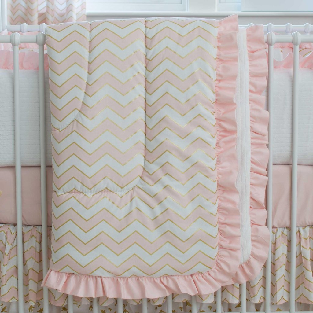 Image of: Pale Pink Gold Chevron Crib Comforter Carousel Design The New Angle On Chevron Crib Bedding Just Released