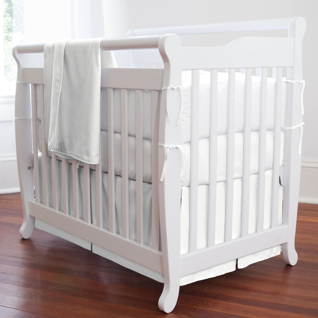 Image of: Solid White Portable Crib Bedding Carousel Design Black and White Crib Bedding Set