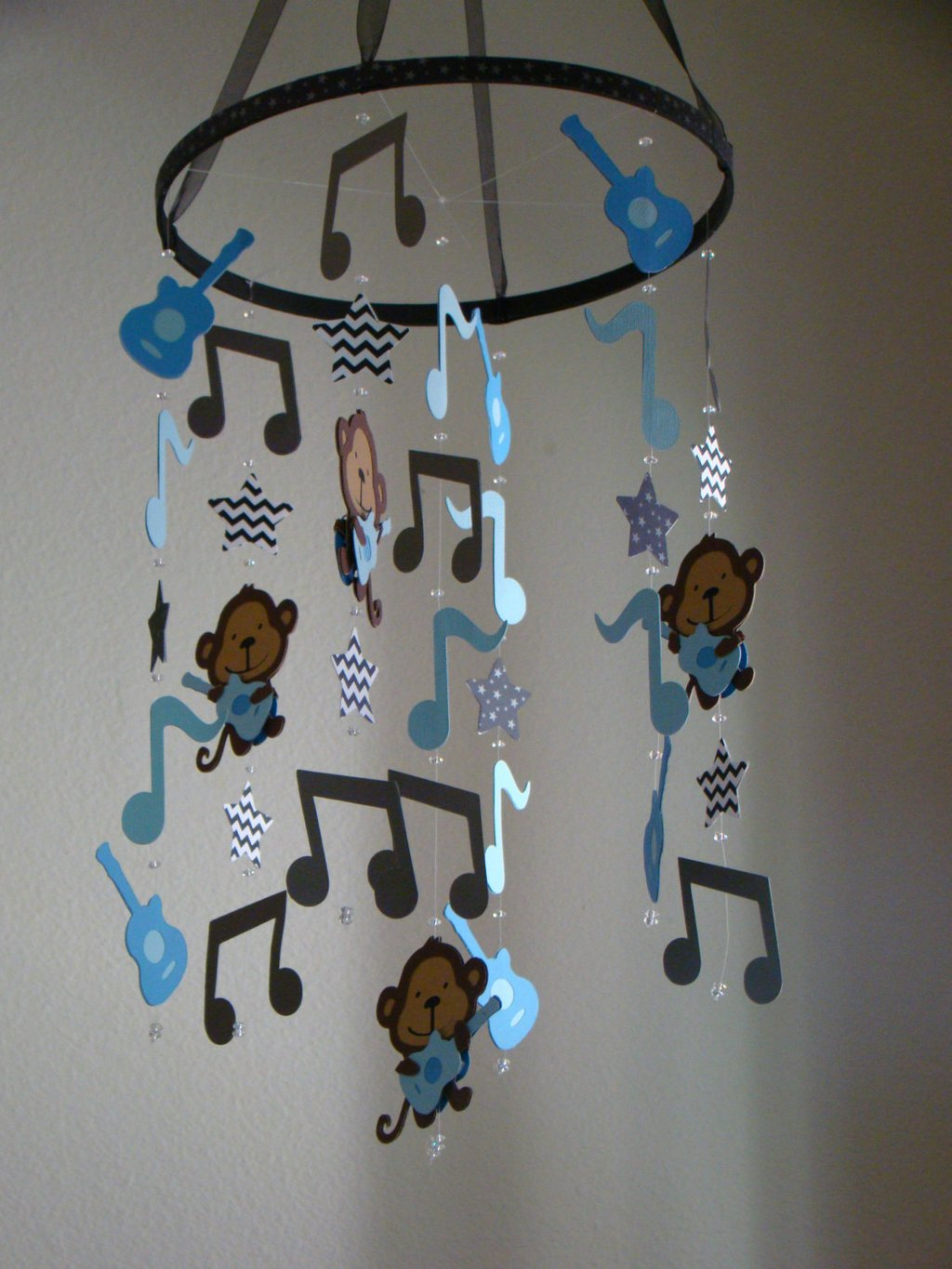 Image of: Rock Star Monkey Guitar Music Note Baby Mobile Blue Gray Themed Music Note Bed Set