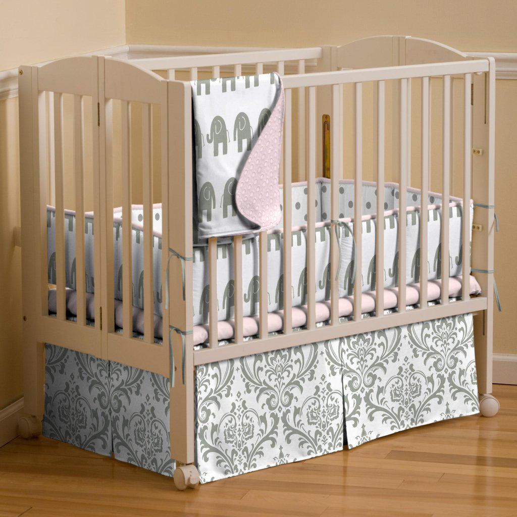 Image of: Pink Gray Elephant Mini Crib Bedding Carousel Design Cute Elephant Baby Girl Bedding Theme