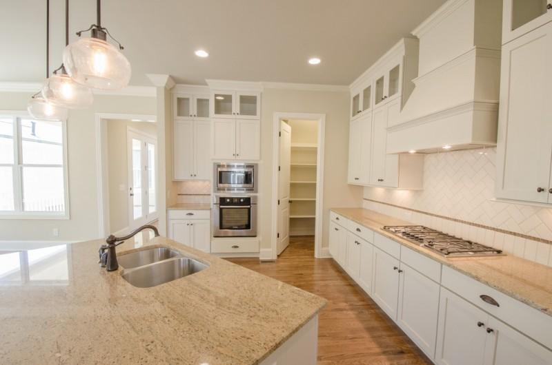 Image of: Beige Granite Countertops With White Cabinets