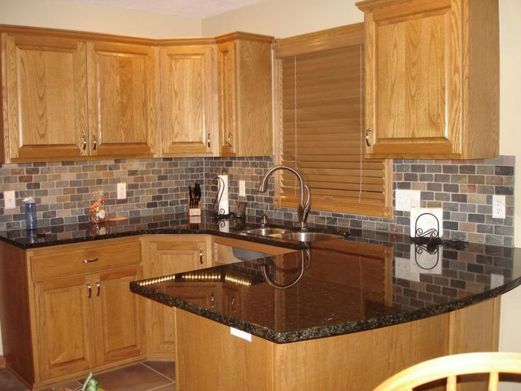 Image of: Black Granite Countertops With Oak Cabinets
