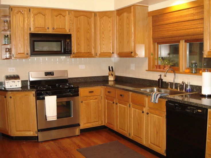 Image of: Popular Granite Countertops With Oak Cabinets