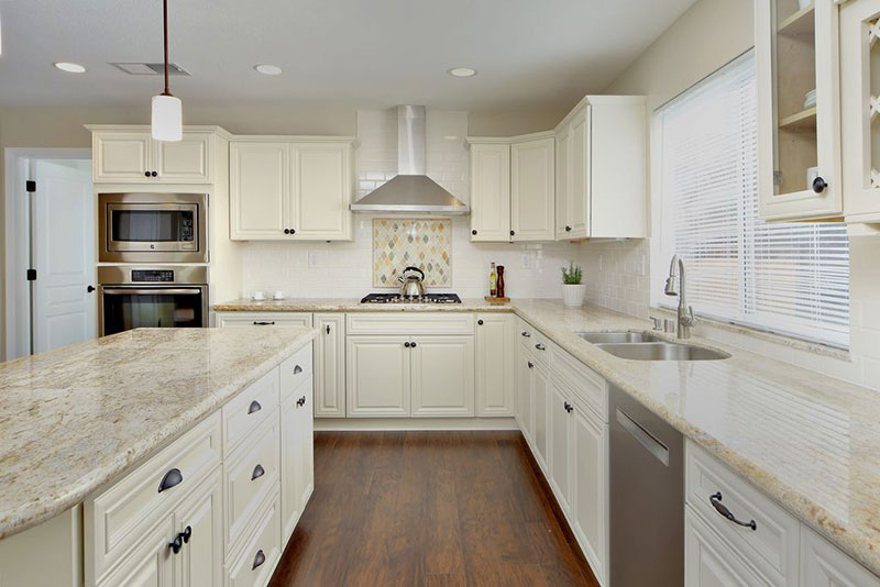 Image of: White Cabinets With White Granite Countertops